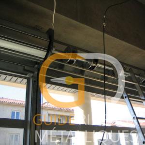 Rideau métallique à manœuvre électrique